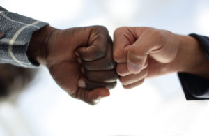 Close up.business partners give each other a fist.